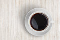 Coffee cup top view on wooden table oak Stock Images
