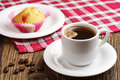 Coffee and cupcake cup of hot with jujube on table Royalty Free Stock Images