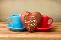 Coffee cups and heart shape chocolate Royalty Free Stock Photos