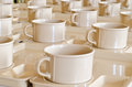 Coffee cups on plates Royalty Free Stock Photo
