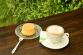 Coffee and custard cake on table in garden Stock Images