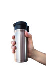 Coffee cylinder hand holding Royalty Free Stock Photography