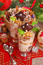 Coffee dessert with honey and nuts for christmas two glasses of chocolate gingerbread cookie Royalty Free Stock Images