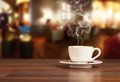 Coffee drink in cafeteria on wooden table with blur as background Stock Image