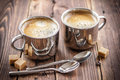 Coffee drink in two cups on a wooden table Royalty Free Stock Photos
