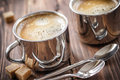 Coffee drink in two cups on a wooden table Royalty Free Stock Images