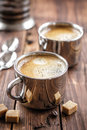 Coffee drink in two cups on a wooden table Stock Photography