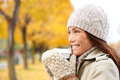 Coffee drinking woman in autumn fall enjoying fall and hot drink from disposable cup smiling happy asian female model Stock Image