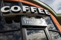 Coffee drive thru sign with reflect from glass window Royalty Free Stock Photo