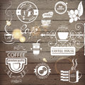 Coffee emblems highly detailed over wooden background Royalty Free Stock Photos