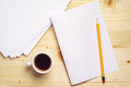 Coffee and empty sheet of paper pencil on wooden table top view Stock Photography