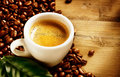 Coffee espresso cup of with beans and green leaf Stock Photography