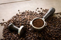 Coffee filter and tamper on coffee beans Royalty Free Stock Photos