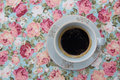 Coffee on the flower tablecloth Stock Images