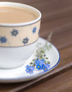 Coffee and forget - me-not Stock Photography