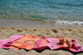 Coffee frappe and pink towel orange on beach by the sea Royalty Free Stock Photo