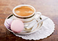 Coffee and french macaroons on a wooden background Stock Image