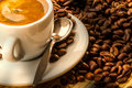 Coffee full cup and beans Stock Images