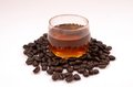 Coffee in a glass of water from fresh beans Stock Photos