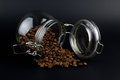 Coffee grains in a glass jar on a black background Royalty Free Stock Photo