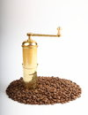 Coffee grains with grinder detail of plenty of copper Stock Photos