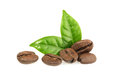 Coffee grains with leaves isolated Royalty Free Stock Photo