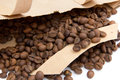 Coffee grains in the paper package brown into Royalty Free Stock Photos