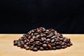 Coffee grains on a wooden board Royalty Free Stock Photo