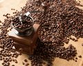 Coffee grinder and beans background on sack Royalty Free Stock Photo