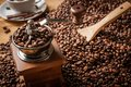 Coffee grinder beans and cup of coffee background on sack Royalty Free Stock Photography