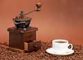 Coffee grinder and cup of coffee Royalty Free Stock Photography