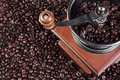 Coffee grinder with fresh roasted beans Royalty Free Stock Images