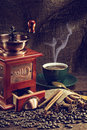 Coffee grinder hot cup of and fresh beans and Royalty Free Stock Photo