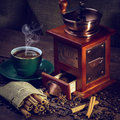 Coffee grinder hot cup of and fresh beans and Stock Image