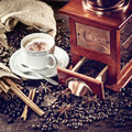 Coffee grinder hot cup of and fresh beans and Royalty Free Stock Photography