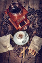 Coffee grinder hot cup of and fresh beans and Royalty Free Stock Images