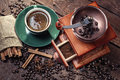 Coffee grinder hot cup of and fresh beans and Royalty Free Stock Photos