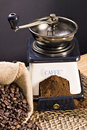 Coffee grinder and roasted coffee beans Royalty Free Stock Photo