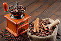 Coffee grinder and sack with coffee beans Stock Image