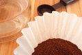 Coffee grounds in filter with pot and measurement scoop Stock Photo