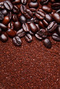 Coffee grounds and whole beans background Royalty Free Stock Image