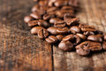 Coffee on grunge wooden background macro Stock Photos