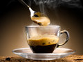 Coffee hot steaming served in a glass cup Stock Images