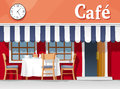 Coffee house small street cafe with striped awning with table and chairs cups plates cake and Royalty Free Stock Images