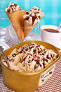 Coffee ice cream in plastic box and cones Royalty Free Stock Photo