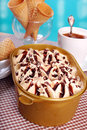 Coffee ice cream in plastic box and cones Royalty Free Stock Photo