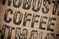 Coffee inscription top view stapm on the hemp bag Stock Photos