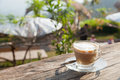 Coffee laid on wooden terrace in the early morning hours the sunlight shines down Stock Images