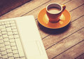 Coffee and laptop cup of on wooden table Stock Photo