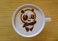 Coffee with latte art to create image of panda this is a very cute and creative beverage presentation Stock Images